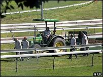 Employees work on the Royal Randwick Racecourse