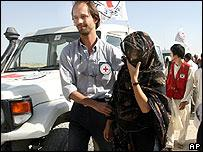 A South Korean hostage (R) is accompanied by an International Red Cross worker after her release by the Taleban