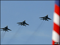 Royal Malaysian Air Force MiG-29 fighters fly in formation over the historic Merdeka Square