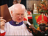 William Leo Murdoch holds the bible at All Saints Cathedral, Nairobi, Kenya, during the Service of Consecration and Installation