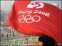 Man waves a flag with the Olympic Games logo in Beijing (file photo)