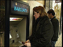 Customer at a Barclays ATM