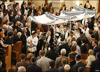 Rabbis carrying a Torah scroll