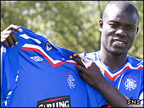 Amdy Faye shows off his new Rangers' colours