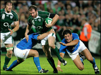 Geordan Murphy is tackled by Italy's Alessandro Troncon at Ravenhill