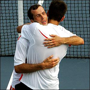 Radek Stepanek and Novak Djokovic hug