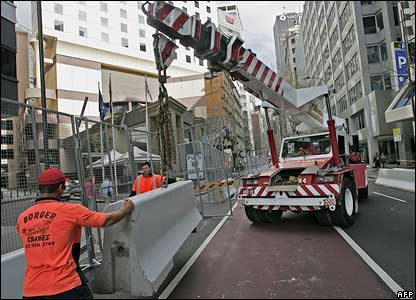 Workers build a security fence in Sydney