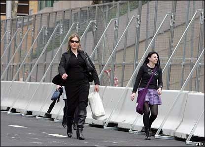 People walk along the fence in Sydney