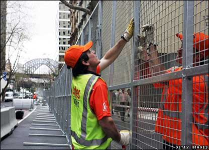 Builders work on the security fence in Sydney