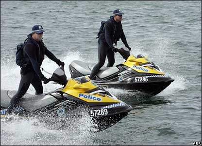 Police patrol on jet-ski around the Sydney harbour