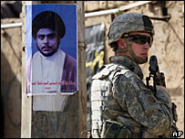 US soldier beside poster of Moqtada al-Sadr - file picture