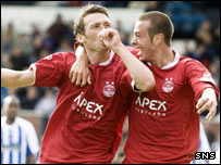 Goalscorer Lee Miller is congratulated by team-mate Andrew Considine