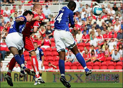 Wheater beats Birmingham's defenders to the ball