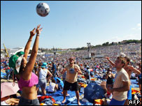 Young people play volley ball as they wait for the arrival of Pope Benedict near Loreto, Italy