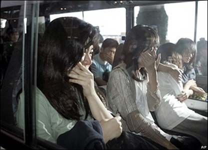 Former hostages weep as they take bus from airport