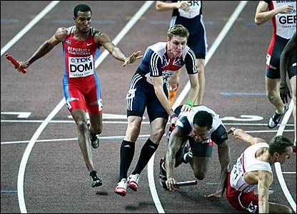 Great Britain's Richard Buck (second left) is impeded by fallers in the 4x400m relay