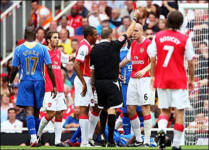 Referee Mark Halsey shows Phillippe Senderos the red card