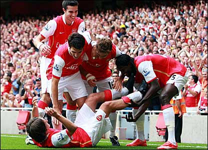 Tomas Rosicky (on ground) is congratulated after scoring Arsenal's third goal