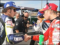 Valentino Rossi (left) has conceded the title to Casey Stoner (right)