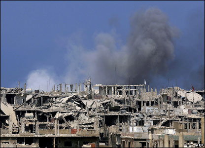 Smoke rises from damaged buildings in the besieged Palestinian camp of Nahr al-Bared (file photo)