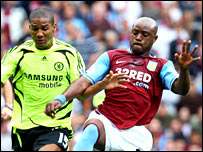 Nigel Reo-Coker and Florent Malouda battle at Villa Park