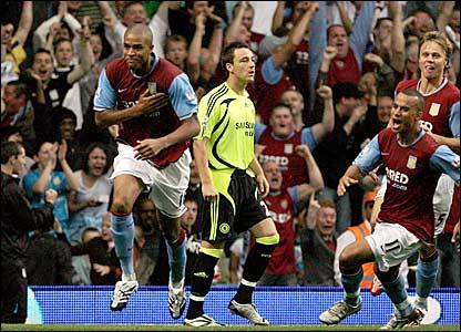 Zat Knight (left) wheels away in celebration after giving Aston Villa the lead