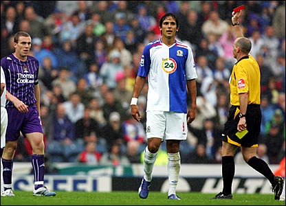 Blackburn's Tugay is shown the red card (Manchester City skipper Richard Dunne (right) is later sent off in a separate incident)