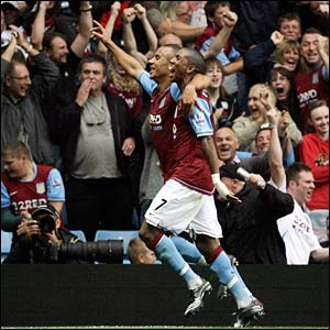 Ashley Young and Gabriel Agbonlahor celebrate Aston Villa's second goal against Chelsea