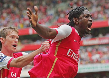 Emmanuel Adebayor celebrates scoring Arsenal's opener