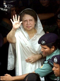 Khaleda Zia waves at her supporters after being arrested