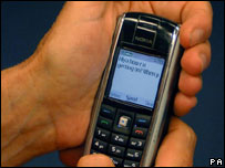 Text message on mobile phone, PA