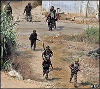 Lebanese soldiers patrol adjacent to the Nahr al-Bared camp