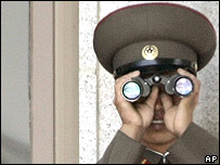 North Korean soldier observes the South Korean side from the demilitarised zone (archive photo)