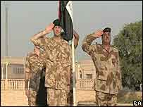 Iraqi flag is raised at Basra Palace during the handover by UK troops