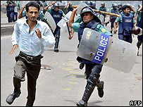 Policeman chases student in Dhaka during August 2007 protests