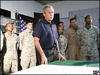 President George W Bush attends a briefing in Iraq