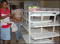 A family stares at empty shelves in a store in Harare, Zimbabwe