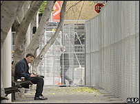 Man sits on a bench next to the security fence in central Sydney - 04/09/07