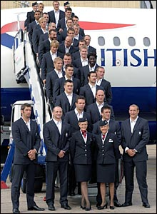 The England rugby team poses on the steps of a plane before flying out to France for the World Cup
