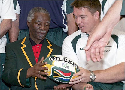 South Africa captain John Smit presents Thabo Mbeki with a rugby ball at a pre-World Cup ceremony in the republic