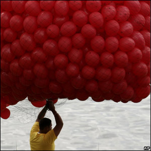 A man holds balloons in readiness for the ceremony