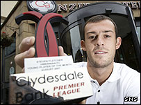 Steven Fletcher shows off his Young Player of the Month prize