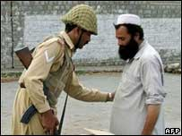 Pakistani soldier searching man in North Waziristan