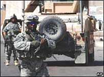 US soldiers guard a checkpoint in western Baghdad on 4 September 2007