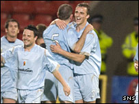 Gary Harkins (centre, right) celebrates putting Partick 2-1 in front at Firhill