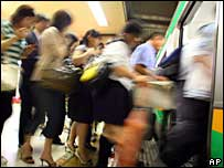 Passengers near Tokyo boarding a train 22/06/07