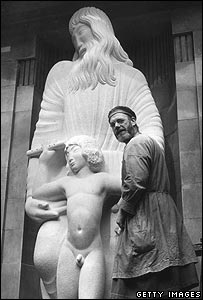 Eric Gill works on Prospero and Ariel at the BBC's Broadcasting House