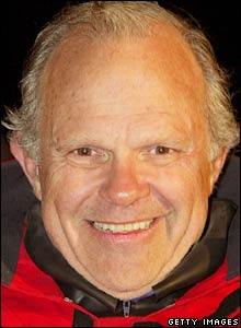 Steve Fossett celebrates breaking the world record for sailing non-stop around the world in 2004