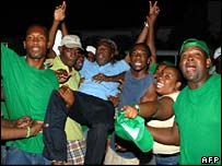 JLP party workers celebrate after first vote count on Monday night