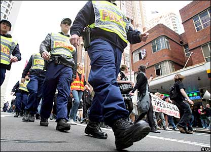 Police guarding students as they march at an anti-Bush demonstration in Sydney 05/09/07